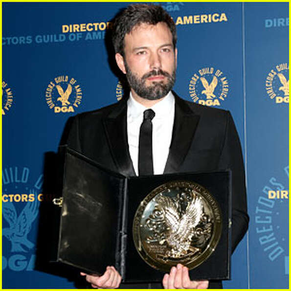 Ben Affleck holding his best director award backstage at the Directors Guild Awards ceremony