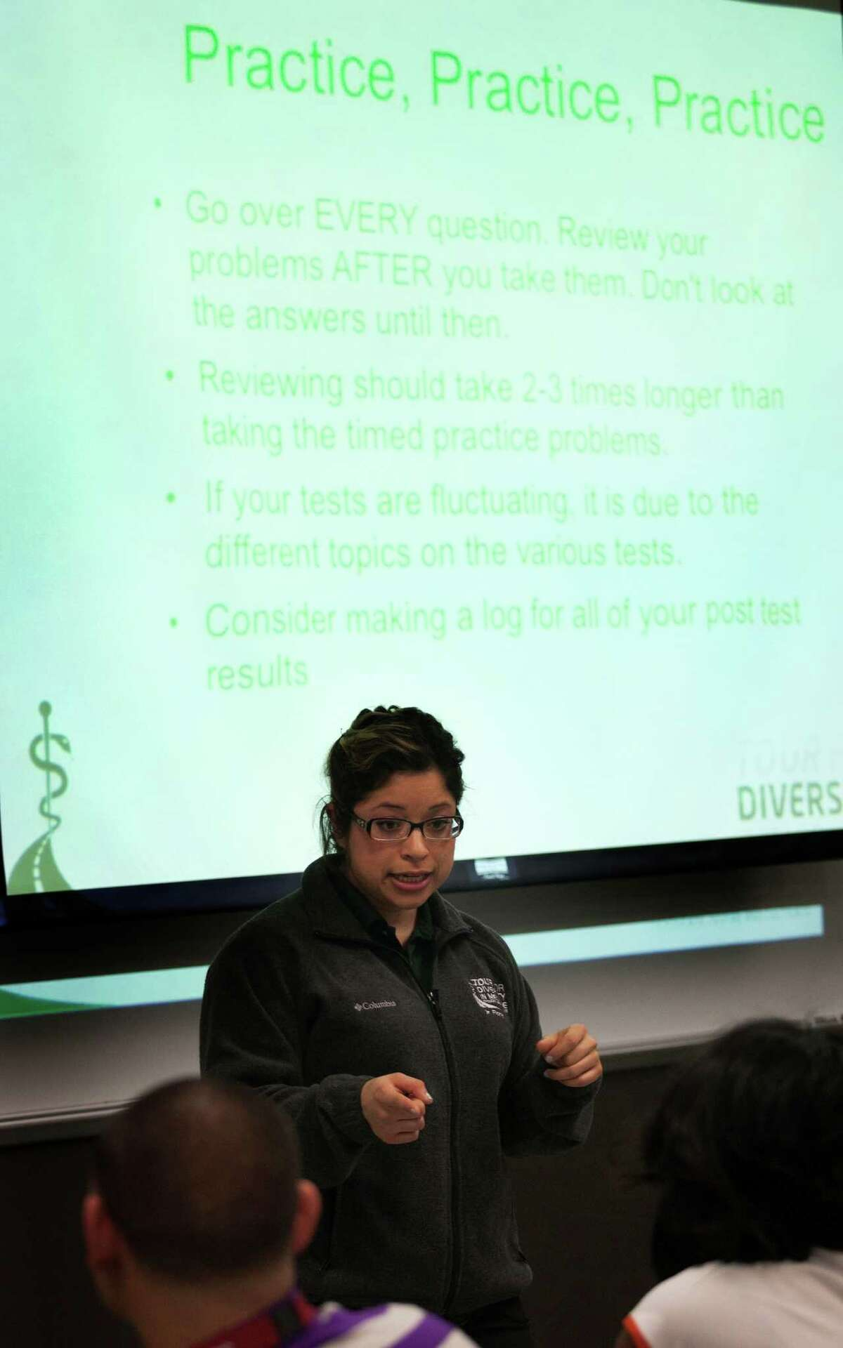 Fourth year medical student Erika Flores-Uribe answers question about the MCAT test during the Tour for Diversity in Medicine at Texas Southern University on Saturday, Feb. 16, 2013, in Houston. The tour was on campus this weekend to encourage minority students to pursue careers in medicine and dentistry.