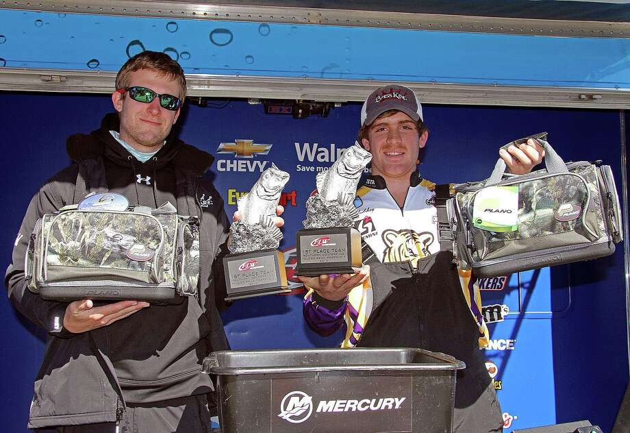 LSU's Richard Murdock and Beau Hadskey received a nice package of Plano products, along with their trophies and cash winnings at Toledo Bend.  (Photo by David Brown)