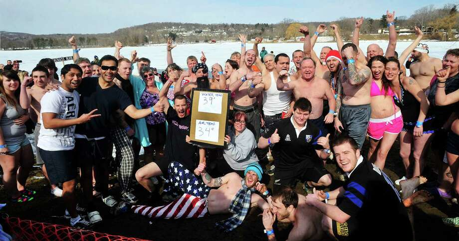 Dippers pose for the crowd of spectators before plunging into the icy waters of Lake Kenosia, outside the Moose Lodge, at the Jack Knapp Sr. Danbury Dip for Charity Saturday, Feb. 16, 2013, in Conn. Photo: Michael Duffy / The News-Times