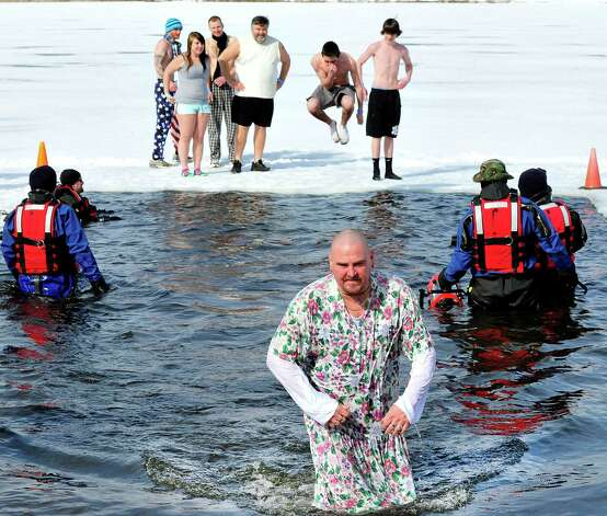 "A ""well dressed"" George Stepeck comes out of the water of Lake Kenosia at the Jack Knapp Sr. Danbury Dip for Charity Saturday, Feb. 16, 2013, in Conn. Photo: Michael Duffy / The News-Times"