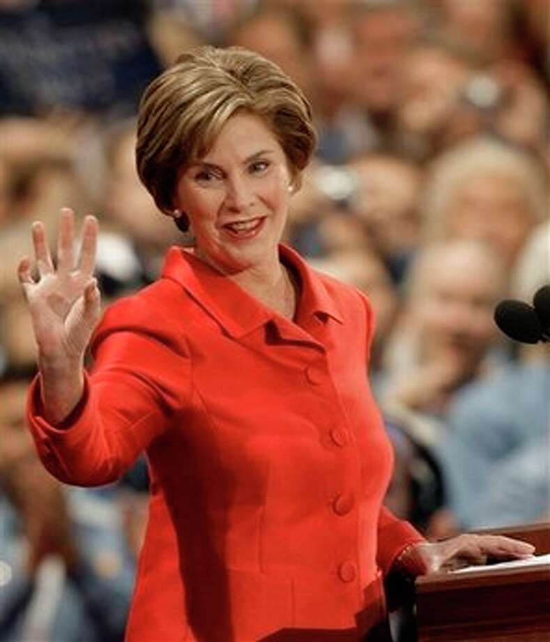 First lady Laura Bush waves to the crowed as she gets ready to speak at the Republican National Convention in St. Paul, Minn., Tuesday, Sept. 2, 2008. Photo: Paul Sancya, AP / AP