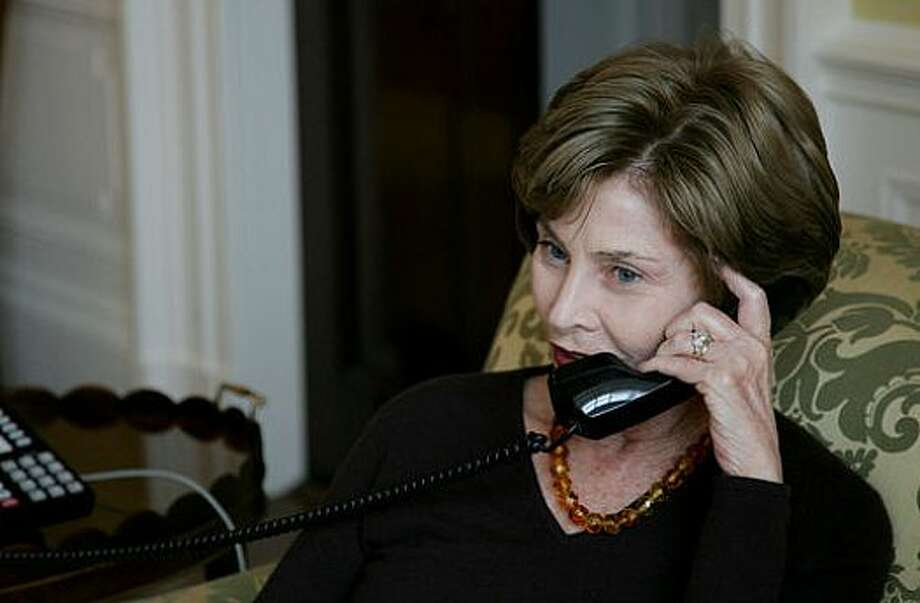 Laura Bush calls incoming first lady Michelle Obama on Jan. 20, 2009.