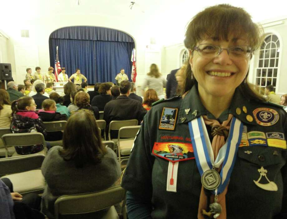Joyce Ference wears her Silver Beaver award at a recent Court of Honor meeting at Greenfield Hill Congregational Church Memorial Hall, where scouts from Troop 90 advanced in rank. Photo: Meg Barone / Fairfield Citizen freelance