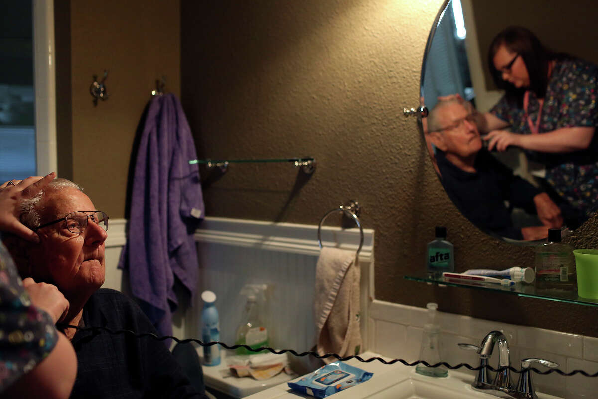 Kayla Hester, CNA, of Nurse Next Door home health care, shaves George Roeber, 92, before helping him with his shower at his home in San Antonio on Friday, Feb. 1, 2013.