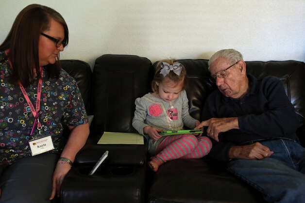 George Roeber, 92, plays with his granddaughter Sadie Schuetze, 3, as Kayla Hester, CNA, of Nurse Next Door home health care, looks on at his home in San Antonio on Friday, Feb. 1, 2013. Photo: Lisa Krantz, San Antonio Express-News / © 2012 San Antonio Express-News