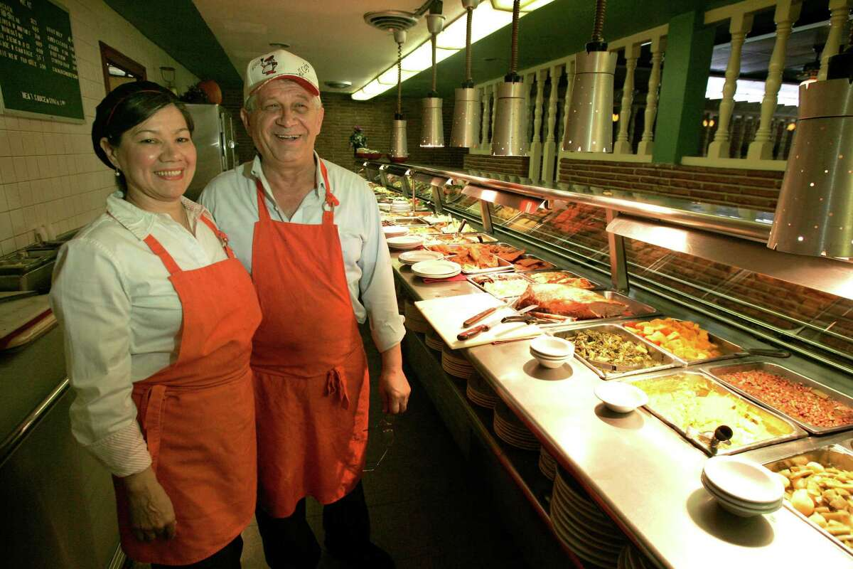 This 2005 photo shows Bill (right) and Dominga (left) Zavouris, who own the Dinner Bell Cafeteria at 6525 Lawndale.