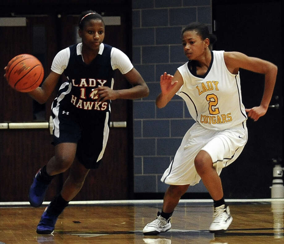 Lady Hawk Kesha Broussard, #14, drives down the court during the La Marque High School Lady Cougars Class 3A playoff girls basketball game against Hardin-Jefferson Lady Hawks at Barbers Hill High School on Thursday, February 14, 2013. Lady Cougars, 73 - 61. Photo taken: Randy Edwards/The Enterprise
