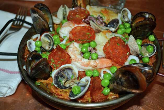 Seafood paella, with mussels, scallops, clams, calamari, shrimp and thin slices of chorizo, is one of the many flavorful dishes at Picador, 15 Elm St., New Canaan. Photo: Contributed