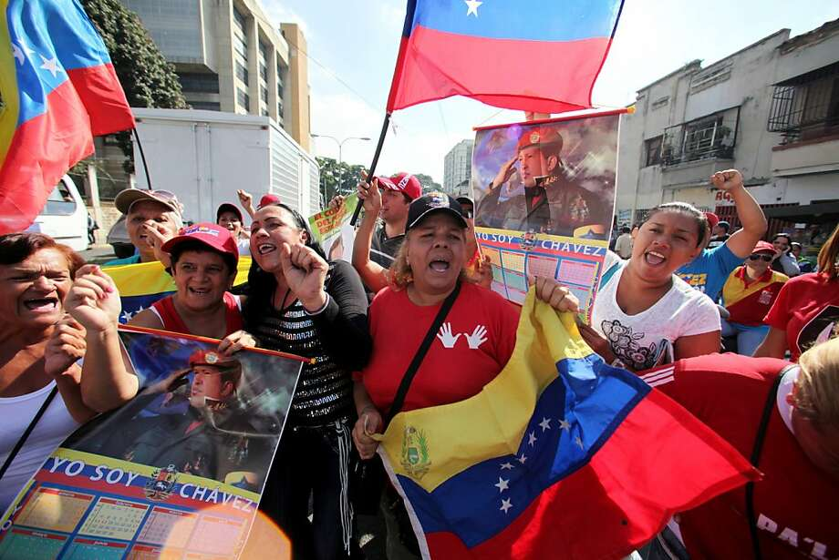 Supporters of President Hugo Chavez celebrate his return outside the Dr. Carlos Arvelo Military Hospital in Caracas. Photo: Fernando Llano, Associated Press