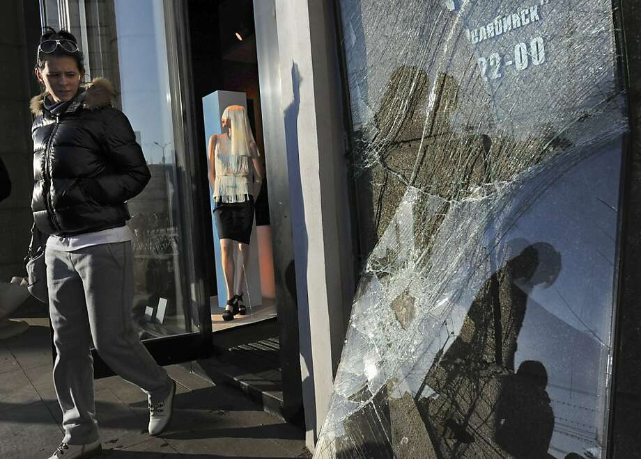 A broken shop window in Chelyabinsk, Russia, is part of the $33 million in meteor damage. Photo: Boris Kaulin, Associated Press