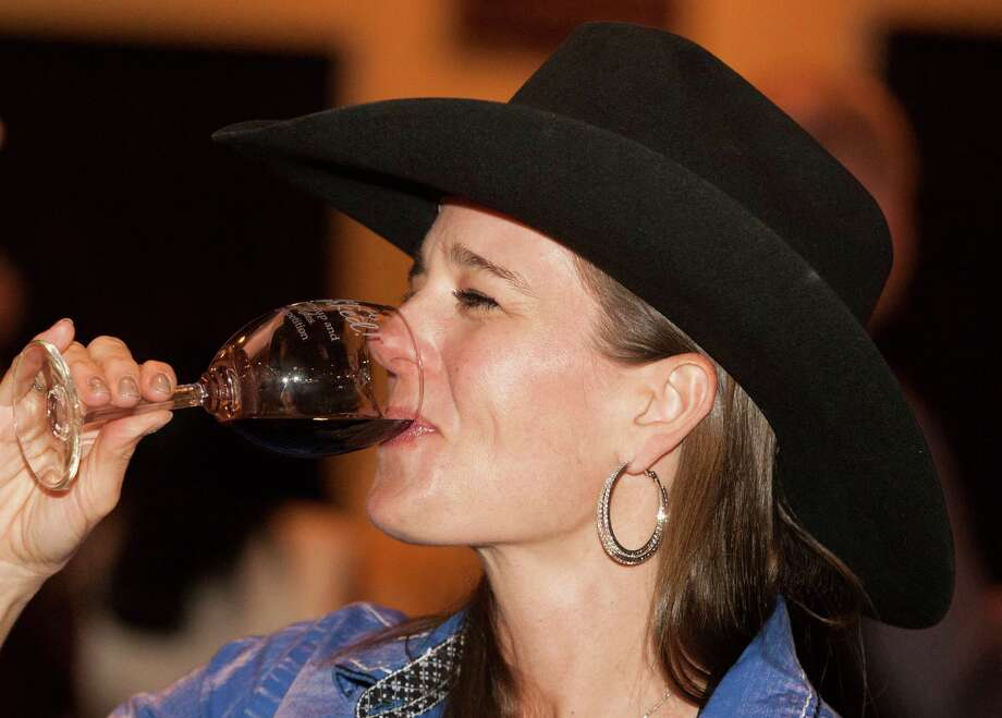 Natalie Matthews enjoys a glass of wine during Rodeo Uncorked at Reliant Center on Sunday, Feb. 17, 2013, in Houston. ( J. Patric Schneider / For the Chronicle ) Photo: J. Patric Schneider, Freelance / © 2013 Houston Chronicle