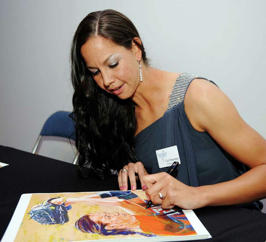 Former Texas softball pitcher Cat Osterman signs a poster at a reception before the induction for the 2013 class of the Texas Sports Hall of Fame, Monday, Feb. 18, 2013, in Waco, Texas. Photo: Rod Aydelotte, Associated Press / The Waco Tribune-Herald