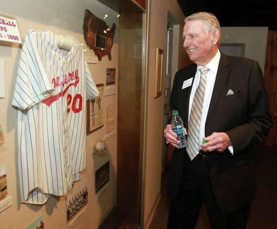 Former high school baseball coach Bobby Moegle looks his display booth at a reception before the induction for the 2013 class of the Texas Sports Hall of Fame, Monday, Feb. 18, 2013, in Waco, Texas. Photo: Rod Aydelotte, Associated Press / Waco Tribune Herald