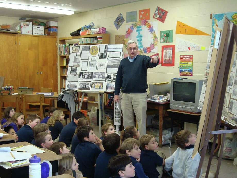 Charles Filkins from the Hoosick Falls Historical Society visited the second, third, and fourth grade classes at St. Mary's Academy on the one hundredth day of school.  He showed the children what the community looked like 100 years ago and talked about what has changed (and why) and what has remained the same. (Submitted photo)