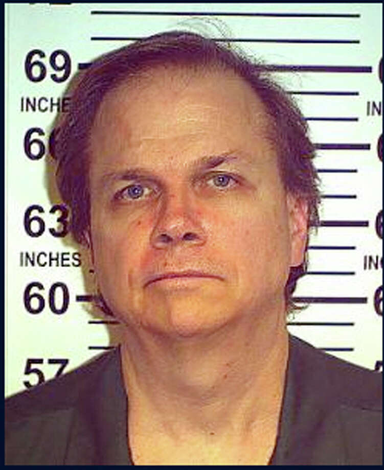 FILE - This May 15, 2012 file photo provided by the New York State Department of Corrections shows Mark David Chapman at the Wende Correctional Facility in Alden, N.Y.  Four letters from John Lennon's killer to the New York police officer who arrested him are on sale through a Los Angeles auction house. Gary Zimet, owner Moments in Time, said the letters from Mark David Chapman to Stephen Spiro are for sale starting Monday, Feb. 18, 2013 for a fixed price of $75,000. Zimet says he is selling the letters on behalf of Spiro, who arrested Chapman on Dec. 8, 1980, shortly after Lennon was shot outside his Manhattan building.  (AP Photo/New York State Department of Corrections, File) Photo: Uncredited