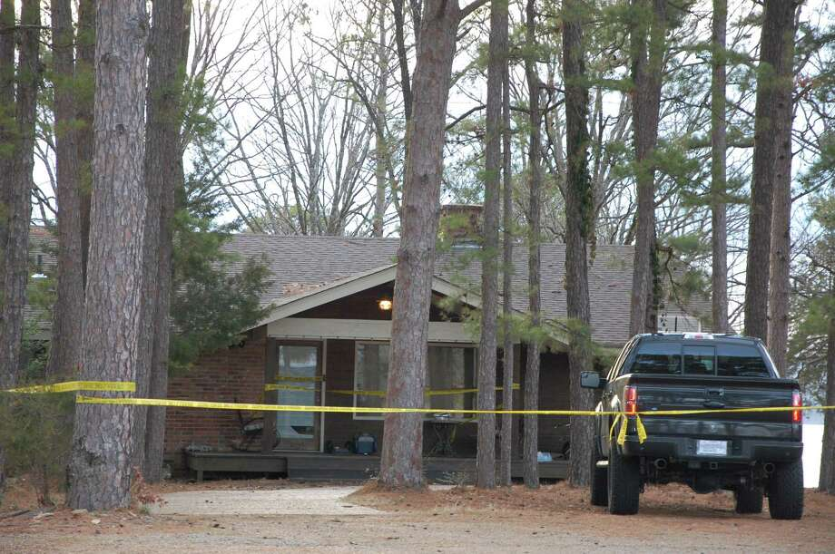 Yellow crime-scene tape blocks off the home of Mindy McCready in Heber Springs, Ark., on Monday, Feb. 18, 2013, the day after the country singer was found dead there Sunday in an apparent suicide. She was 37. (AP Photo/Jeannie Nuss) Photo: Jeannie Nuss
