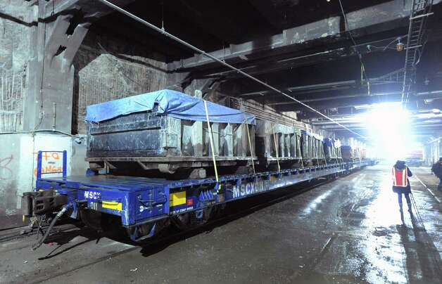 Railroad cars covered with tarps that are used to transport debris out of the Metropolitan Transportation Authority's East Side Access Project construction area, New York City, Tuesday, Jan. 29, 2013. The project will connect the Long Island Rail Road's (LIRR) Main and Port Washington lines in Queens to a new LIRR terminal beneath Grand Central Terminal in Manhattan. Photo: Bob Luckey / Greenwich Time