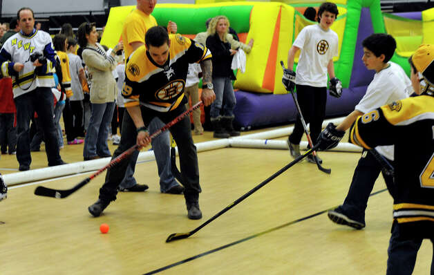 Boston Bruin player, Tyler Seguin, participates in a hockey clinic for Newtown kids at the Newtown Youth Academy, Monday, Feb. 18, 2013. Photo: Carol Kaliff / The News-Times