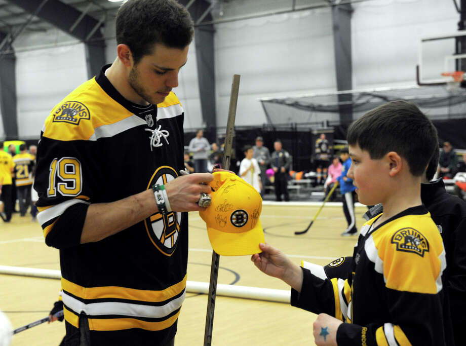Boston Bruin player, Tyler Seguin, signs autographs at a hockey clinic for Newtown kids at the Newtown Youth Academy, Monday, Feb. 18, 2013. Photo: Carol Kaliff / The News-Times