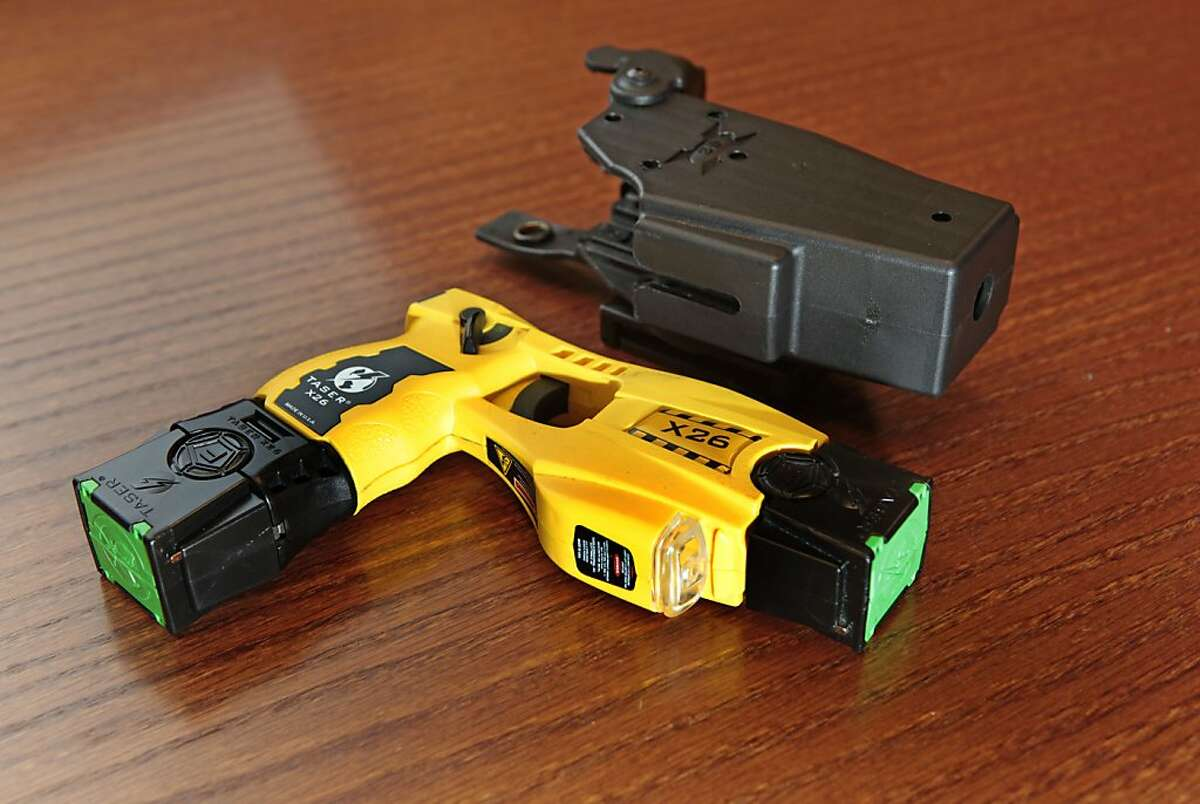San Francisco is among the last major U.S. cities that do not arm police forces with stun guns like this Taser and holster.