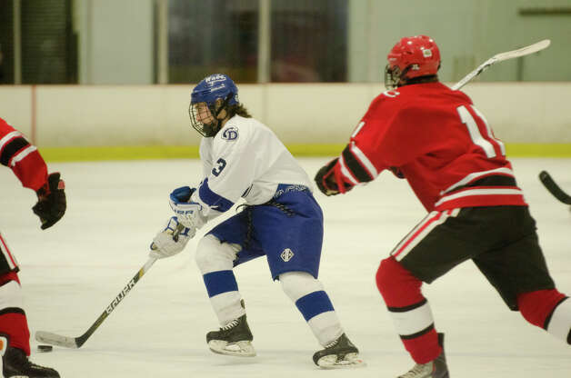 Darien's Tommy Watters (3) controls the puck during the second period of the boys hockey game against New Canaan High School at Darien Ice Rink on Monday, Feb. 18, 2013. Photo: Amy Mortensen / Connecticut Post Freelance