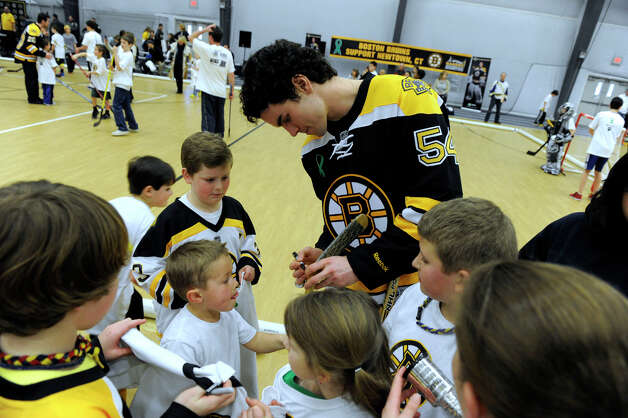 Adam McQuaid of the Boston Bruins hockey team signs autographs for held hockey clinics for Newtown kids at the Newtown Youth Academy, Monday, Feb. 18, 2013. Photo: Carol Kaliff / The News-Times