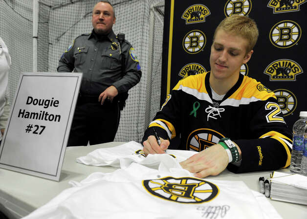 Boston Bruin player Dougie Hamilton signs autographs Monday. The Boston Bruins hockey team held hockey clinics for Newtown kids at the Newtown Youth Academy, Monday, Feb. 18, 2013. Photo: Carol Kaliff / The News-Times