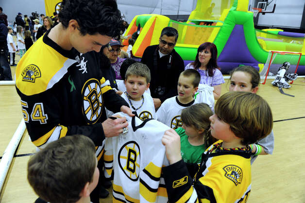 Adam McQuaid of the Boston Bruins hockey team signs autographs at a hockey clinic for Newtown kids at the Newtown Youth Academy, Monday, Feb. 18, 2013. Photo: Carol Kaliff / The News-Times