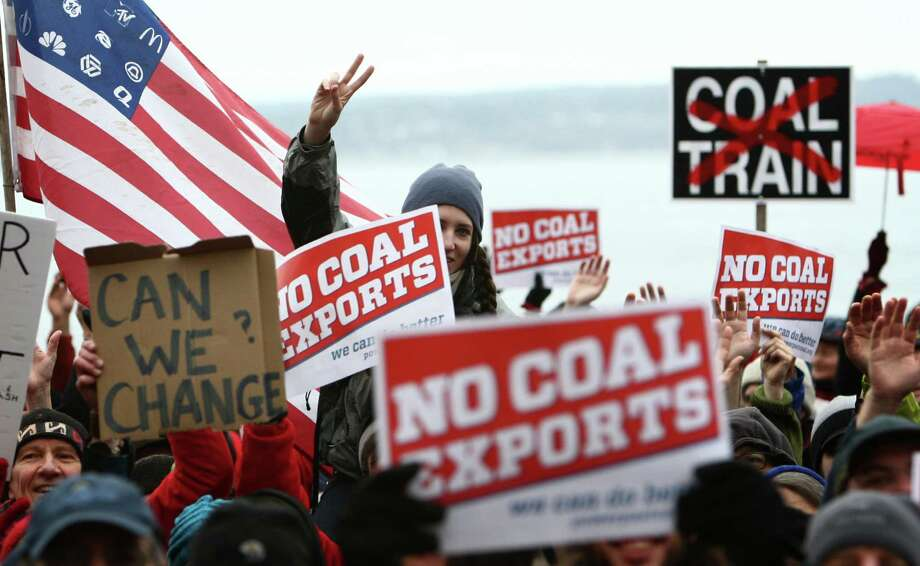 People gather during a protest against proposed coal trains that would pass through Seattle. The trains are part of a proposal to ship coal from the U.S. via rail to ships and eventually to Asia. Opposition to the plan has been fierce, especially in Western Washington. Photo: JOSHUA TRUJILLO / SEATTLEPI.COM