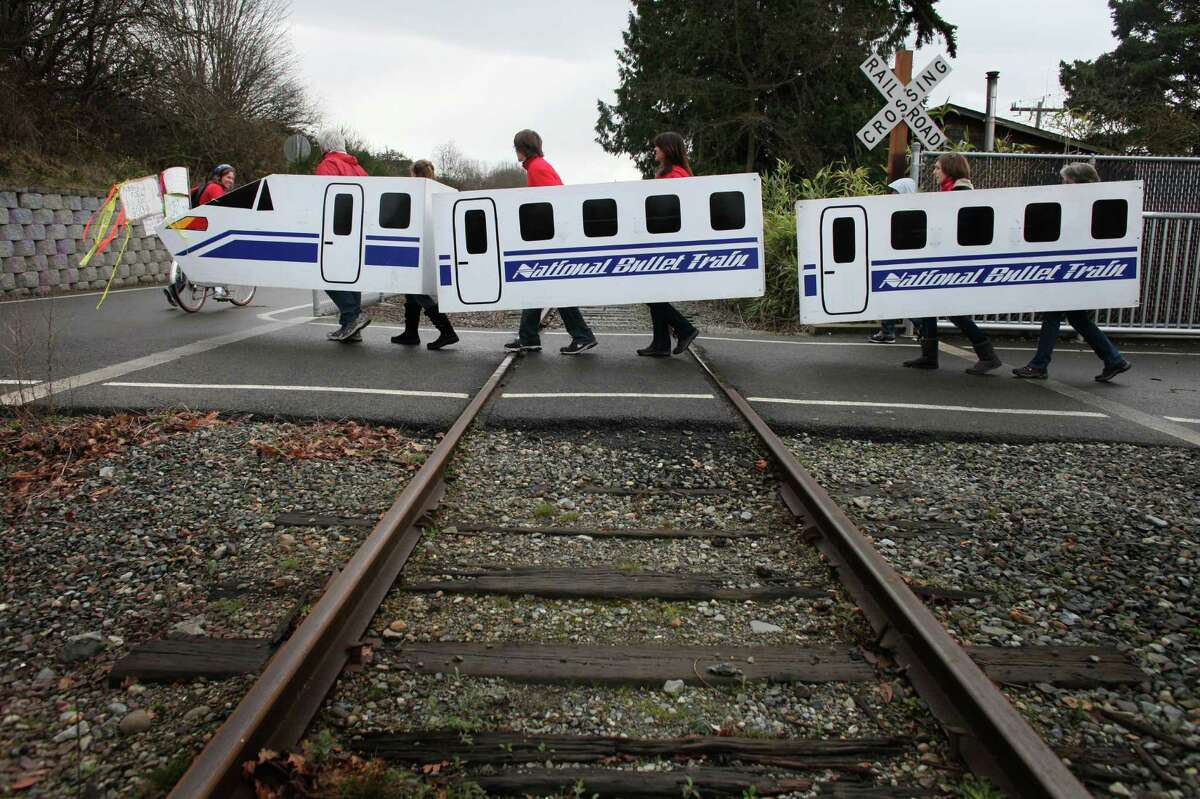 A protest prop crosses railroad tracks during a protest against proposed coal trains that would pass through Seattle on Sunday, February 17, 2013 at Seattle's Golden Garden's Park. The trains are part of a proposal to ship coal from the U.S. via rail to ships and eventually to Asia. Opposition to the plan has been fierce, especially in Western Washington.