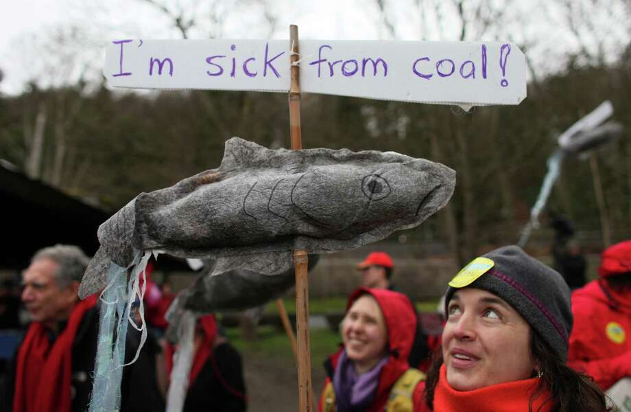 Lenore Bussing carries a sign during a protest against proposed coal trains. Photo: JOSHUA TRUJILLO / SEATTLEPI.COM