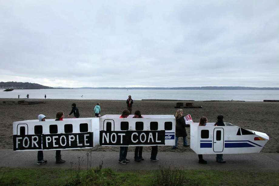 A prop is carried during a protest against proposed coal trains. Photo: JOSHUA TRUJILLO / SEATTLEPI.COM