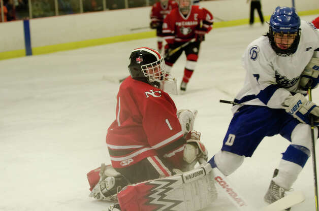 New Canaan's goalie Christopher Koennecke (1) protects the goal during the boys hockey game against Darien High School at Darien Ice Rink on Monday, Feb. 18, 2013. Photo: Amy Mortensen / Connecticut Post Freelance