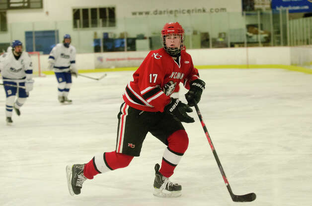 New Canaan's Stephen Mettler (17) on the ice during the boys hockey game against Darien High School at Darien Ice Rink on Monday, Feb. 18, 2013. Photo: Amy Mortensen / Connecticut Post Freelance
