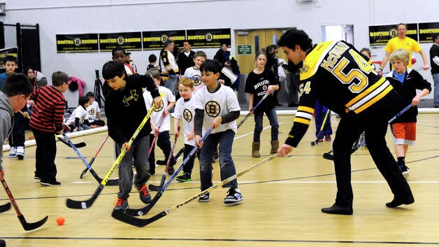 Adam McQuaid of the Boston Bruins hockey particiaptes in a hockey clinic for Newtown kids at the Newtown Youth Academy, Monday, Feb. 18, 2013. Photo: Carol Kaliff / The News-Times