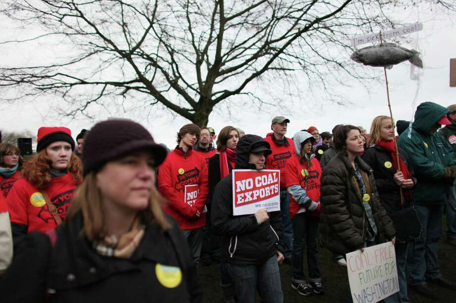 People gather during a protest against proposed coal trains that would pass through Seattle at Seattle's Golden Garden's Park. The trains are part of a proposal to ship coal from the U.S. via rail to ships and eventually to Asia. Opposition to the plan has been fierce, especially in Western Washington. Photo: JOSHUA TRUJILLO / SEATTLEPI.COM