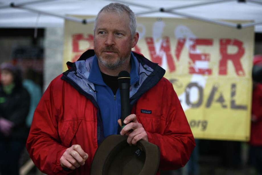 """Seattle Mayor Mike McGinn speaks during a protest against proposed coal trains that would pass through Seattle on Sunday, February 17, 2013 at Seattle's Golden Garden's Park. McGinn is a """"conviction politician."""" Climate change is a key issue for the Mayor. Photo: JOSHUA TRUJILLO / SEATTLEPI.COM"""
