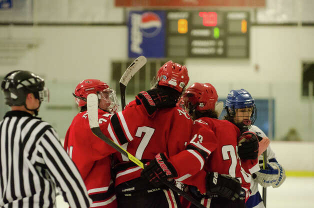 New Canaan's Stephen Mettler (17) celebrates a goal with teammates during the boys hockey game against Darien High School at Darien Ice Rink on Monday, Feb. 18, 2013. Photo: Amy Mortensen / Connecticut Post Freelance