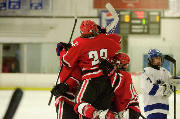New Canaan celebrates a goal during the boys hockey game against Darien High School at Darien Ice Rink on Monday, Feb. 18, 2013. Photo: Amy Mortensen / Connecticut Post Freelance