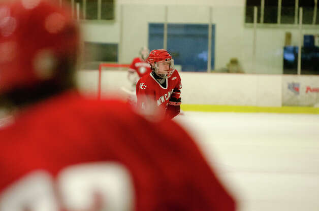New Canaan's Matthew Bruch (14) on the ice during the boys hockey game against Darien High School at Darien Ice Rink on Monday, Feb. 18, 2013. Photo: Amy Mortensen / Connecticut Post Freelance