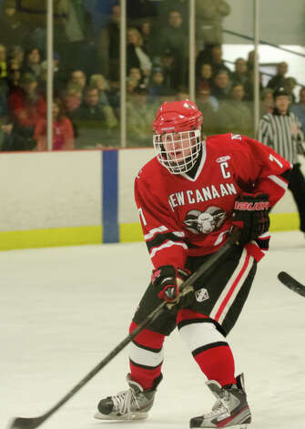 New Canaan's Benjamin Patch (7) on the ice during the boys hockey game against Darien High School at Darien Ice Rink on Monday, Feb. 18, 2013. Photo: Amy Mortensen / Connecticut Post Freelance