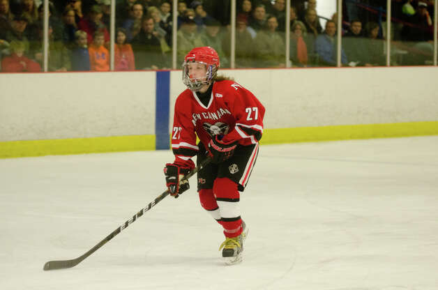 New Canaan's Cooper Manchuck (27) on the ice during the boys hockey game against Darien High School at Darien Ice Rink on Monday, Feb. 18, 2013. Photo: Amy Mortensen / Connecticut Post Freelance