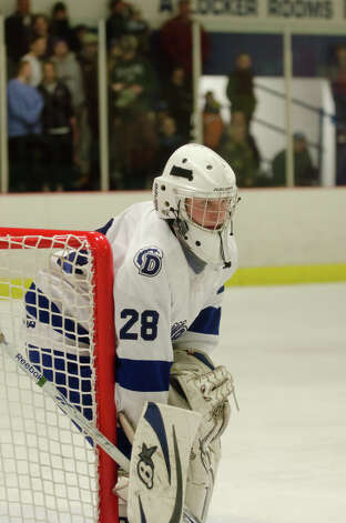 Darien's Michael Collins (28) on the ice during the boys hockey game against New Canaan High School at Darien Ice Rink on Monday, Feb. 18, 2013. Photo: Amy Mortensen / Connecticut Post Freelance