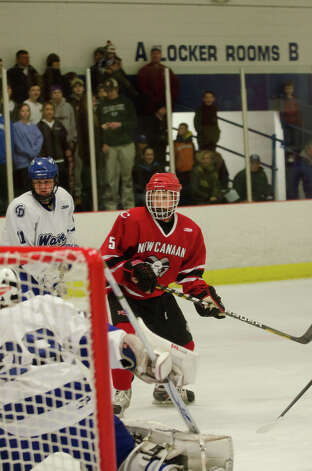 New Canaan's Davis Bruch (5) on the ice during the boys hockey game against Darien High School at Darien Ice Rink on Monday, Feb. 18, 2013. Photo: Amy Mortensen / Connecticut Post Freelance