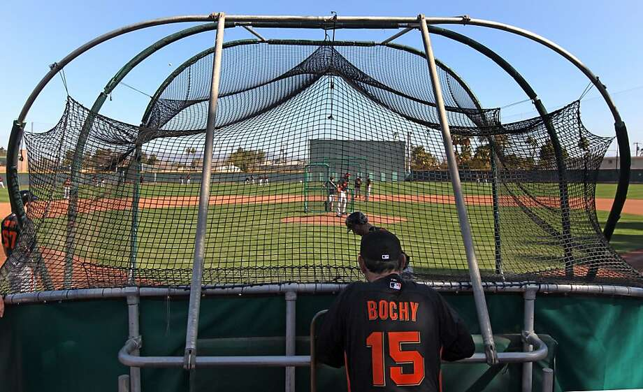 Manager Bruce Bochy has an excellent vantage point to watch the Giants' first day of live batting practice this spring. Photo: Lance Iversen, The Chronicle