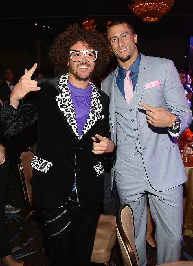 Colin Kaepernick's brief vacation included a pre-Grammy event with Redfoo of LMFAO. Photo: Larry Busacca, Getty Images For NARAS
