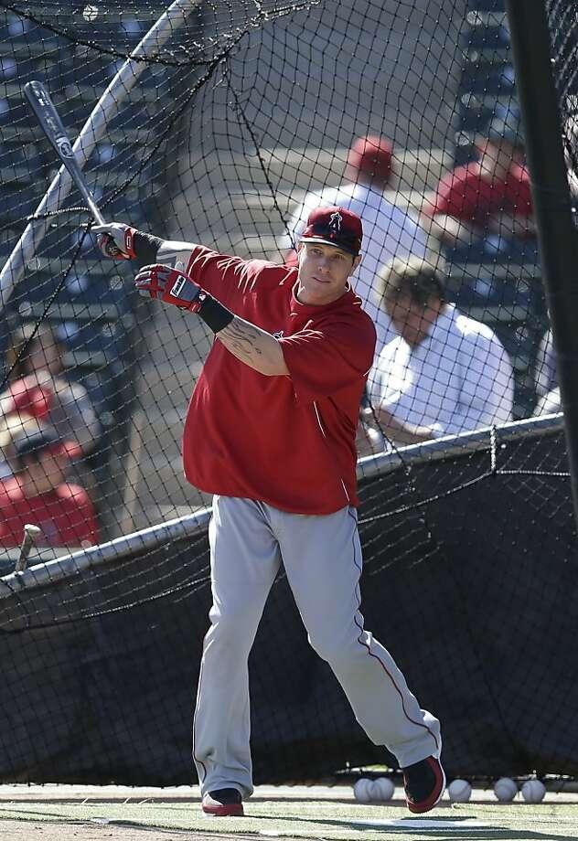 Los Angeles Angels' Josh Hamilton hits during a spring training baseball workout Monday, Feb. 18, 2013, in Tempe, Ariz. (AP Photo/Morry Gash) Photo: Morry Gash, Associated Press