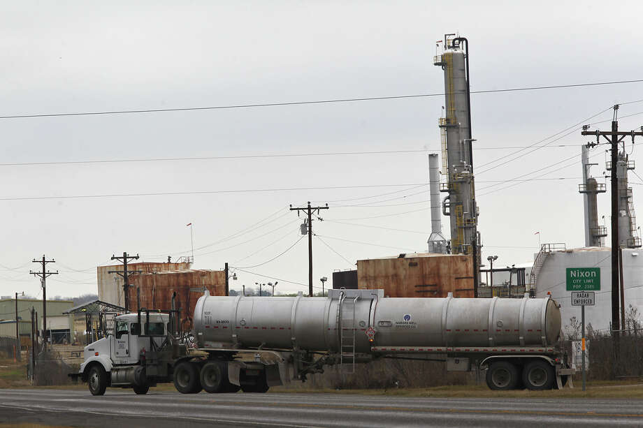 A tanker leaves the Blue Dolphin Energy Nixon refinery. The plant was mothballed for years but now processes Eagle Ford Shale oil. Photo: Jerry Lara, Staff / © 2013 San Antonio Express-News