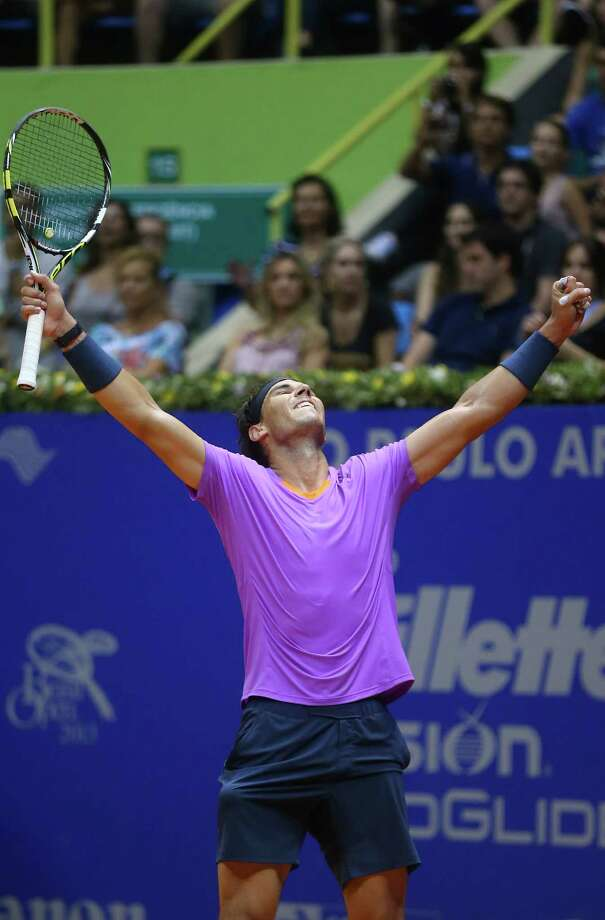 Spain's Rafael Nadal celebrates at the end of the Brazil Open ATP tournament final tennis match against Argentina's David Nalbandian in Sao Paulo, Brazil, Sunday, Feb. 17, 2013. Nadal won 6-2, 6-3. (AP Photo/Andre Penner) Photo: Andre Penner
